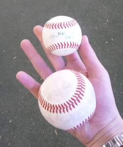 The smaller ball in my hand compared to the regular sized baseball.