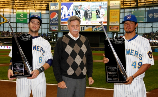 Ryan Braun and Yovani Gallardo receive their 2010 Silver Slugger Awards from Brewers Vice President and General Manager Doug Melvin.