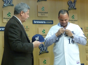 Doug Melvin hands Aramis Ramirez his first Brewers cap