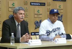 Doug Melvin and Aramis Ramirez at the podium for today's press conference