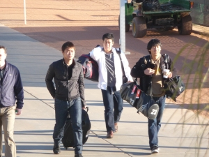 Aoki (left in jeans) arrives to Brewers camp today.