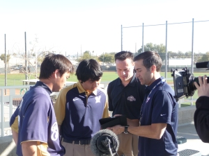 Aoki works with Inaji, Brewers Media Relations Director Mike Vassallo and Matt Vasgersian of MLB Network on a promotional read for the network.