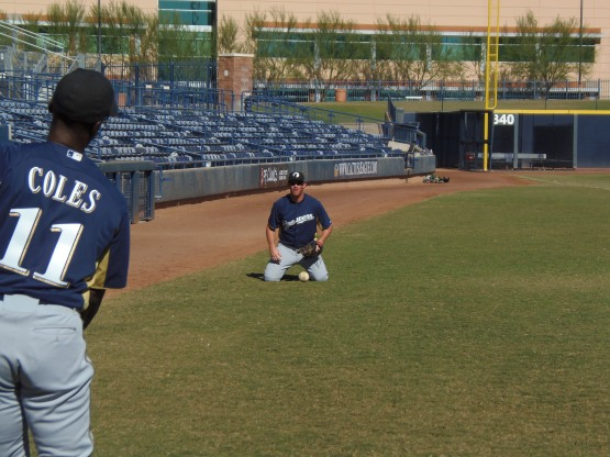 Hunter Morris works on fielding with Darnell Coles prior to today's Arizona Fall League game at Peoria Sports Complex.