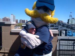 Cait with Bernie Brewer on a rooftop in Chicago