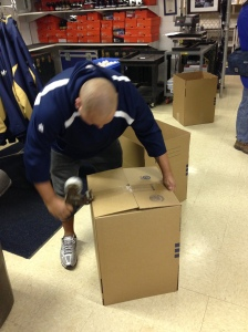 Alex Sanchez making sure the boxes are taped properly.