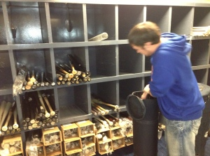 Clubhouse Assistant Ben Pinzer loads up the bats.