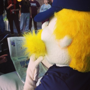 Bernie passes the time waiting for his flight by catching up on Brewers news in the Milwaukee Journal Sentinel....
