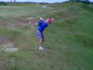 "My dad, at Whistling Straits (he had a ""baa-d lie!"")."