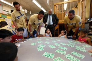 The players practice counting with some K5 students.