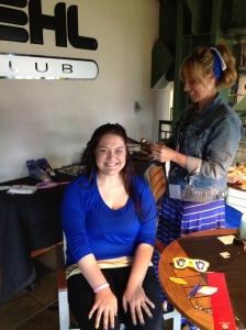 Cindy gets her hair styled with a Brewers accessory.