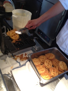 The waffles are made fresh on the griddle at the stand.