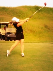 Here I am blasting a drive up the fairway (Joe was really proud of capturing such a great shot--props to him!)
