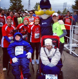 Bernie Brewer poses with some of the myTEAM TRIUMPH runners at the 2012 Brewers Mini Marathon.