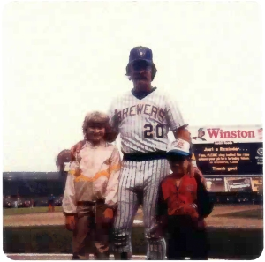 Olympian Erika Brown as a child with her brother, Craig, and favorite player, Gorman Thomas.
