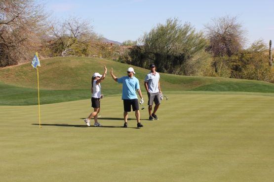 Tyler Thornburg gives me a high five after I made the birdie putt on 8. A disconcerted Kyle looks on.