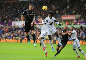 Ben Davies (33) and Wilfred Bony (10) of Swansea City A.F.C.