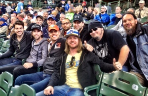 Dustin Lynch (orange Brewers cap) and his band came out to Miller Park for today's Brewers vs. Pirates game.