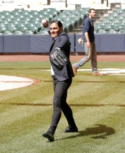 Paco tries his hand at baseball.... Photo Courtesy: Darren Hauck/Milwaukee Brewers