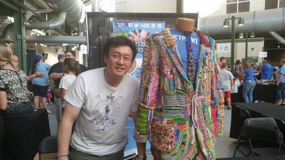 Loom creator Cheong Choon Ng stands next to a Loom suit worn by Jimmy Kimmel.