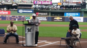 Ted Toles, Jr. addresses the crowd before Saturday's Brewers vs. Mets game.