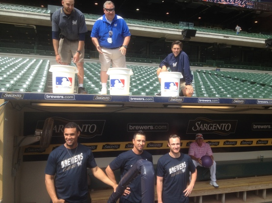 Carlos Gomez, Kyle Lohse & Jonathan Lucroy prepare for the Ice Bucket Challenge while Bob Uecker looks on.