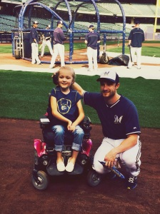 Jonathan Lucroy with Reagan at Miller Park earlier this year.
