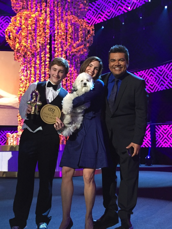 The Dog of the Year, Hank the Ballpark Pup, poses with World Dog Awards Host, George Lopez.