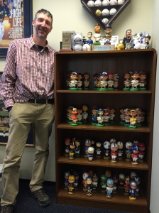 Brewers VP-Controller Joe Zidanic and his vintage bobblehead collection.