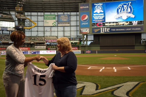Brewers Sr. Director of Community Relations Katina Shaw (left) presents our April Community Achiever Beth David with a jersey.