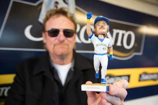 Rob Deer holds up his bobblehead. Photo: Scott Paulus/Milwaukee Brewers