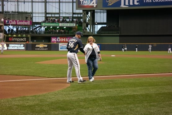 Beth David shakes hands with Coach Joe Crawford after tossing a first pitch at tonight's game.