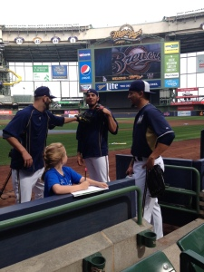 Kelci gets help on her homework from Mike Fiers, Matt Garza and Kyle Lohse.
