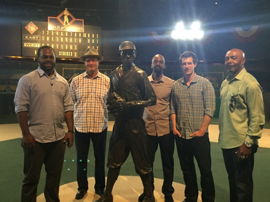 Jason Rogers, Jerry Narron, Darnell Coles, Craig Counsell and John Shelby pose with the statue of Satchel Paige at the Negro Leagues Baseball Museum.