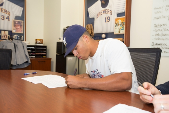 Trent Clark signs his contract at Miller Park. (Photo Courtesy: Scott Paulus/Milwaukee Brewers Baseball Club)