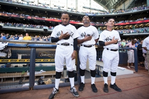 Jeremy Jeffress and coaches Shelby & Guerrero, wearing the Milwaukee Bears uniforms during the national anthem. PHOTO: Scott Paulus/Milwaukee Brewers