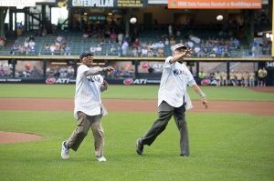 Tonight's honorees James Beckum and Gilbert Hernandez Black throw out ceremonial first pitches. PHOTO: Scott Paulus/Milwaukee Brewers