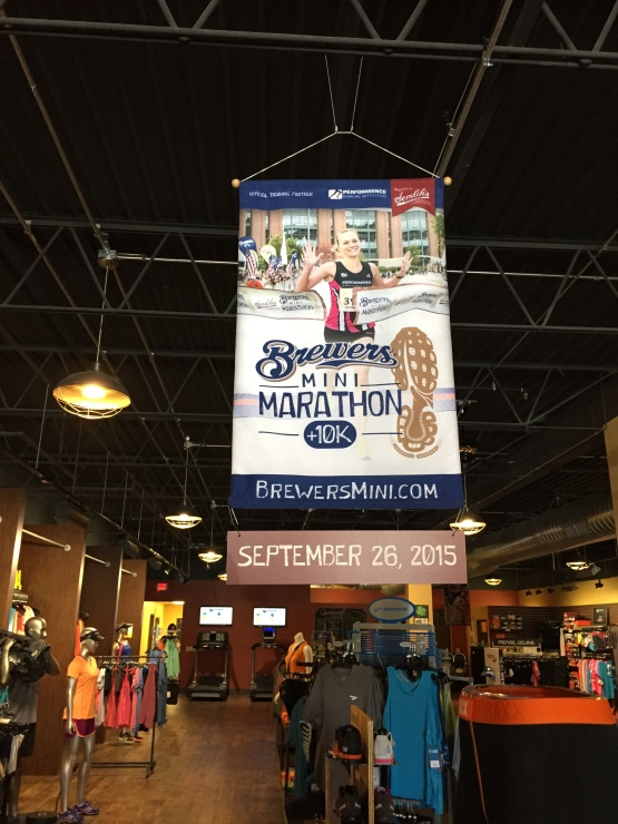 A Brewers Mini-Marathon poster hangs proudly in Performance Running Outfitters' Brookfield location. PRO is the official training partner of the Brewers Mini + 10K.