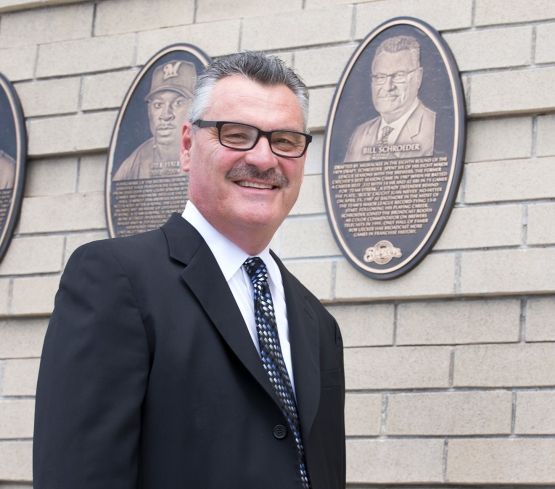 Bill poses next to his plaque outside Miller Park on the Brewers Wall of Honor. Photo: Scott Paulus/Milwaukee Brewers