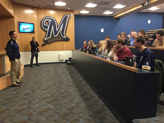 GM David Stearns addresses the class.