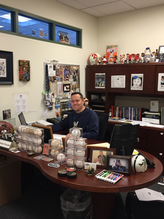 Here sits Senior Director of Media Relations Mike Vassallo. After 20 years in the business, his office is a treasure trove of cherished memorabilia.
