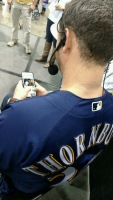 Tyler Thornburg sends a tweet from a fan's phone at On Deck.