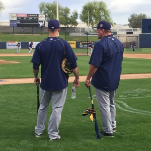 Jonathan Lucroy and Pat Murphy start a conversation during batting practice.