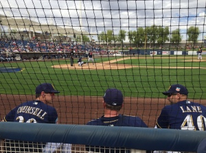 L-R: Manager Craig Counsell, Bench Coach Pat Murphy and Coach Jason Lane. Murphy is always in the middle of a baseball conversation.