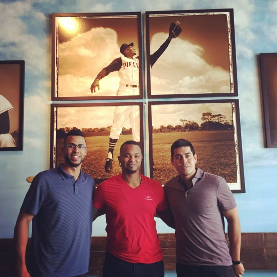 Yadiel Rivera, Martin Maldonado and Ramon Flores pose in front of an amazing photograph of Clemente that Rieder recovered in a dumpster in Puerto. Just one of the many amazing artifacts and stories you'll come across at the museum.