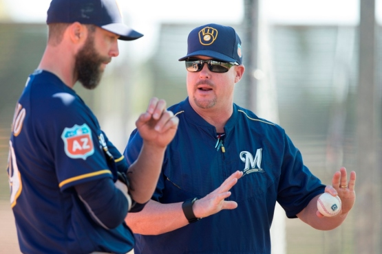 Pitching Coach Derek Johnson works with Chris Capuano in Spring Training. Photo: Scott Paulus/Milwaukee Brewers