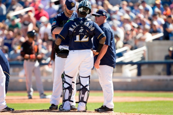 Derek Johnson visits the mound in Spring Training. Contrary to what movies like 'Bull Durham' would have you believe, these guys are not discussing what to get Jimmy for his wedding present. PHOTO: Scott Paulus/Milwaukee Brewers