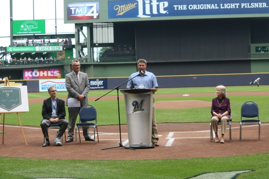 Jay Adcock speaks during the pregame ceremony at Miller Park.