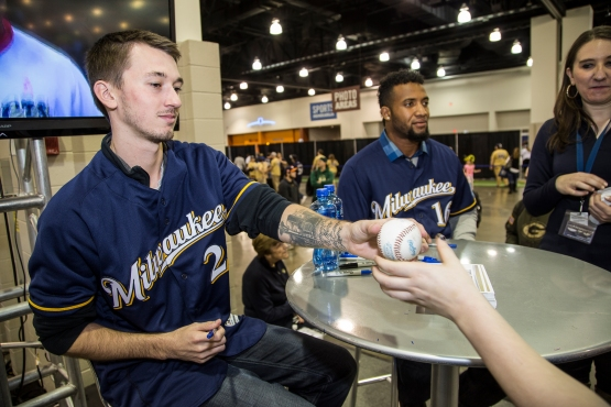 Pitcher Zach Davies signs autographs at Brewers On Deck. Notice the Seattle tattoo on his left forearm.