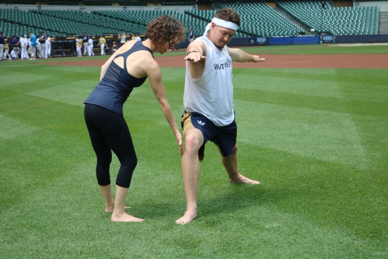 Bliss helps pitcher Corey Knebel perfect his alignment.