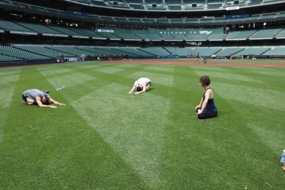 Instructor Pamela Bliss leads some members of the Crew through a yoga practice on the field.